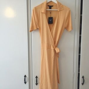 Fin aprikosfärgad klänning från Gant i storlek S. Helt ny!   Ordinarie pris: 1200kr