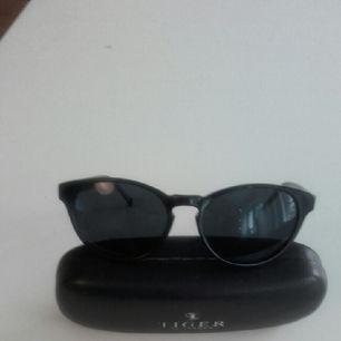 Snygga solglasögon från Tiger. Aldrig använda.