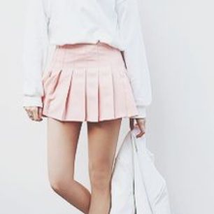 Peachy pink tennis skirt from Chuu. Never used. Has shorts underneath (see pictures)