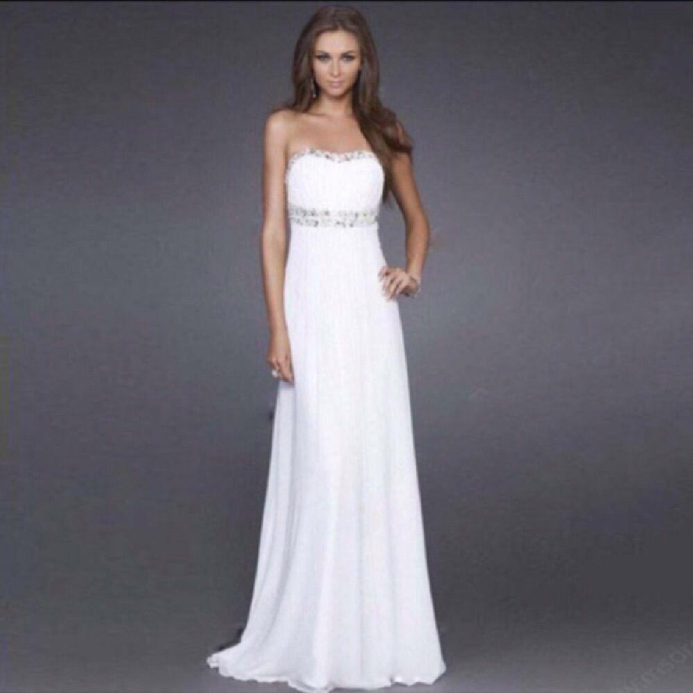 Vit klänning med silvriga detaljer. Aldrig använd . Klänningar. c98523d2c1e5a