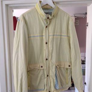 Retro jacket . Yellow (pastel-typo-color)