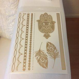 Temporära guldiga tatueringar från GinaTricot