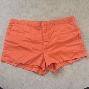 Orange kostymshorts
