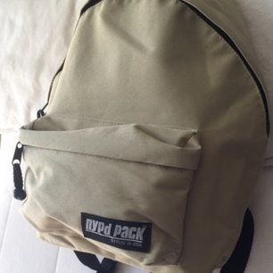 Vintage beige mini backpack from NYPD Pack with small pocket in front. Adjustable straps of handing low or high. Sparsely used and kept stored.