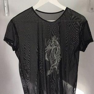 Genomskinlig svart T-shirt ifrån Humana, köparen står för frakt