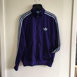 Adidas jacket storlek L.