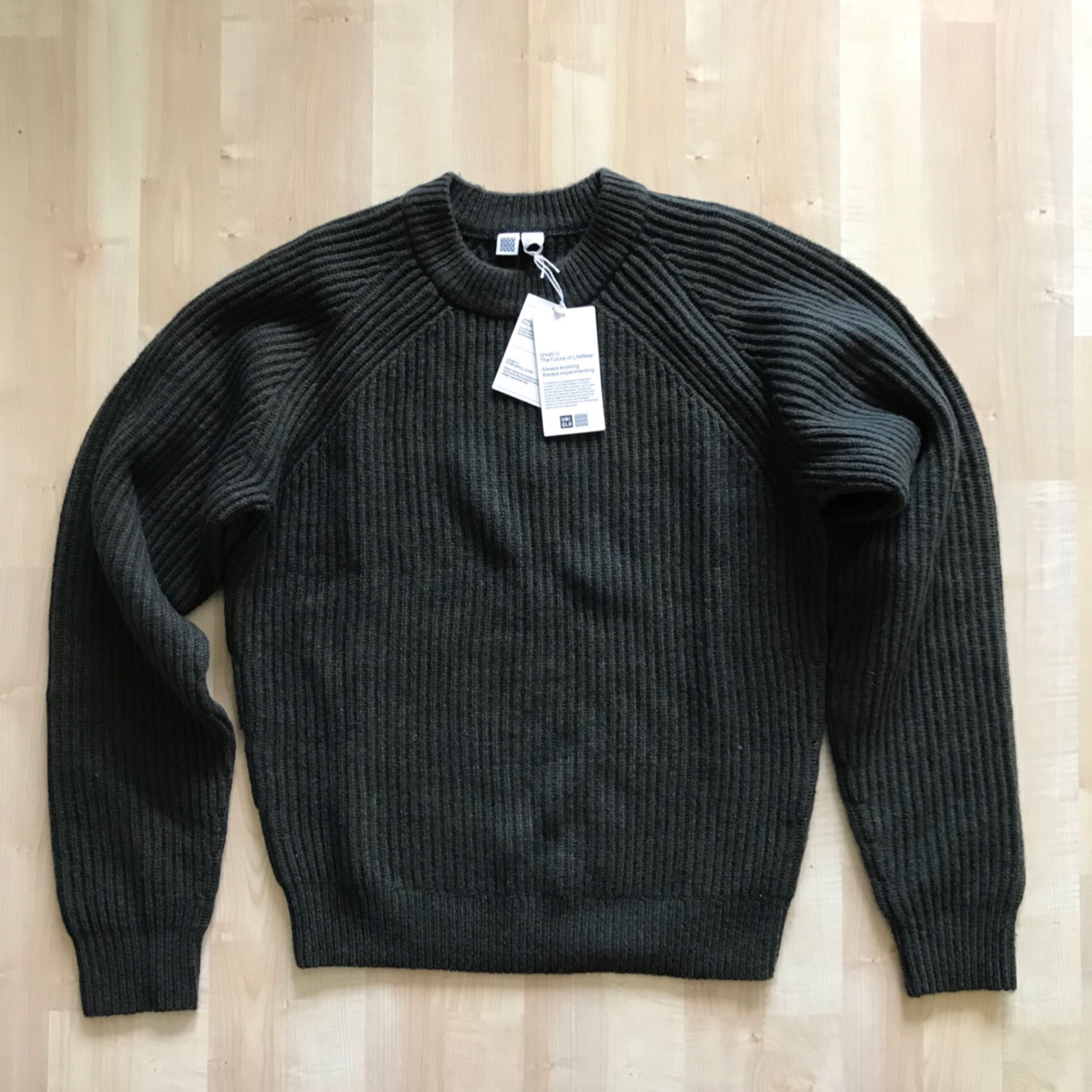 Brand New with tags, Uniqlo U stickat/knitwear jumper in collaboration with famous french designer Christopher Lemaire. Limited edition in lambswool material.  Size is XS but really fits an S size for someone between 170cm to 180cm.   Dark military green in colour.  Bought in Tokyo, Japan.. Stickat.