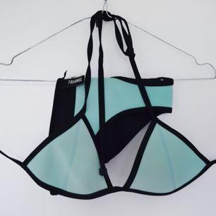 Så fin bikini från TRIANGL i turkos/ljusblå färg. Kommer tyvärr inte till användning. Kan skickas eller mötas upp i Stockholm.