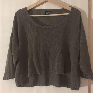 Olivgrön tröja från Cheap Monday. Litet hål på framsida, se bild tre. 100% akryl. Har swish, köparen står för frakt.