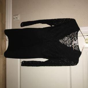 Svart spetsklänning från nelly, använd en gång