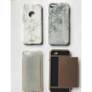 """Mobilskal till iPhone 6! Vitt marmorskal från Ideal of Sweden Grått """"päls""""skal Plast med silverglittrig baksida Lite tjockare skal med plats för upp till två kort på baksidan, väldigt användbart!   50kr/st, hör av er för fler bilder eller frågor :)"""