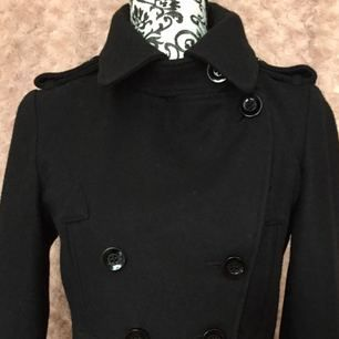 New black, double-breasted jacket from Top Shop. Size EUR38/UK10. Four pockets. Features such as lapels, with matching detail at back of waist as well as cuffs, give this little black jacket that something extra.