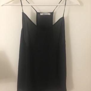 Blus linne från Gina