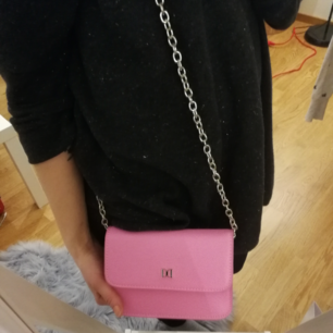 A cute pink clutch from Don Donna