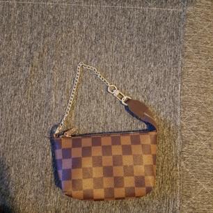 Louis Vuitton plånbok  Ej äkta.  200
