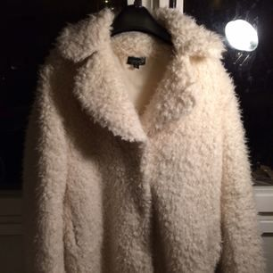 White cozy and warm coat.  Used only a few times.