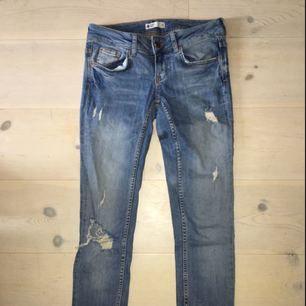 Slitna jeans från Gina Tricot
