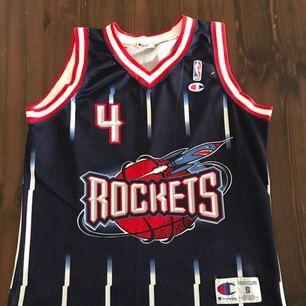 Vintage basketlinne från Champion. NBA Rockets Barkley 4. Hämtas i Uppsala eller skickas mot fraktkostnad