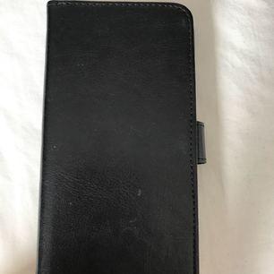 iPhone 7 Plus plånboksfodral, nästintill oanvänd. 30 kr + frakt.