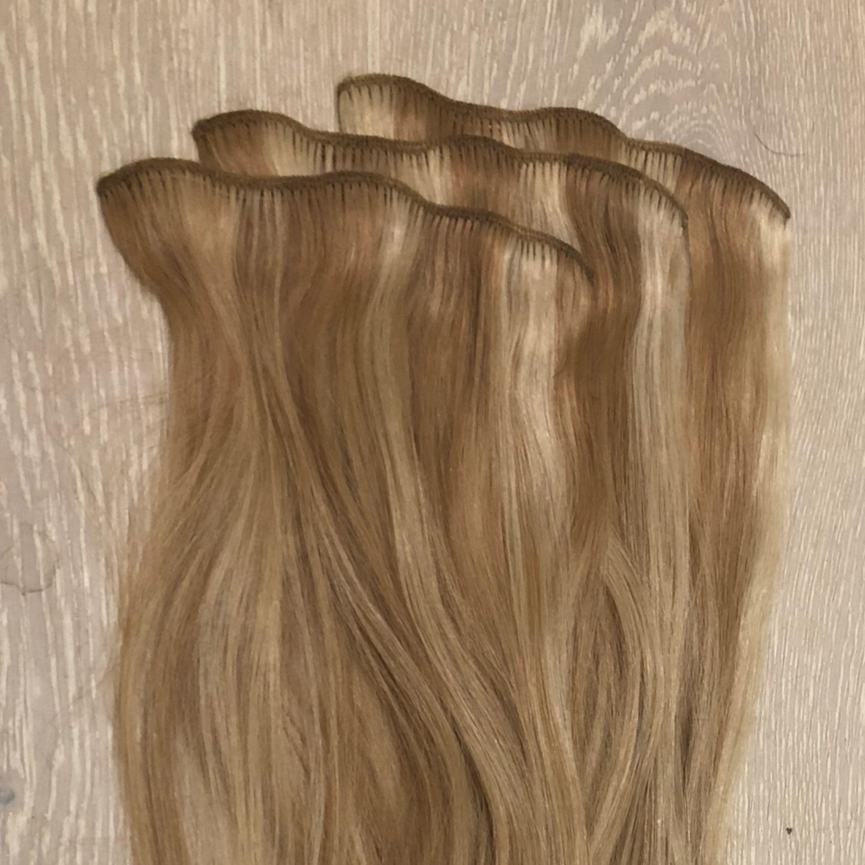 Clip-on set från rapunzel. Använt två gånger. Nyans P14/60 , cendre ash blond mix, längd 50 cm. Accessoarer.
