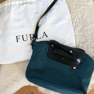 Authentic furla crossbody bag for sale. Beautiful color in natural light. Perfect size, fits everything but still not too big.