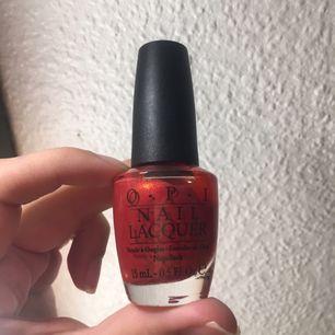 O.p.i nagellack , glittrig röd  Original pris 149 kr Aldrig använd