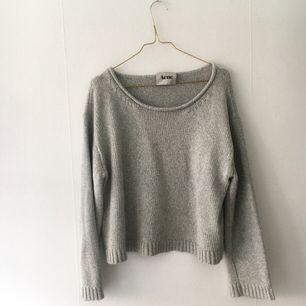 Stickad tröja från ACNE. Fint skick, grön/grå i färgen.