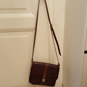 Läderväska med brunt skinn i vintage