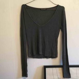 Grå långärmad tröja från Brandy Melville