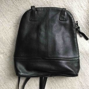 Black soft leather mini-bag. Perfect condition. Lots of pockets. Shipping is extra.