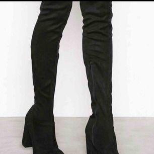 Over knee boots från Nelly i storlek 38, ej använda. Möts endast upp.