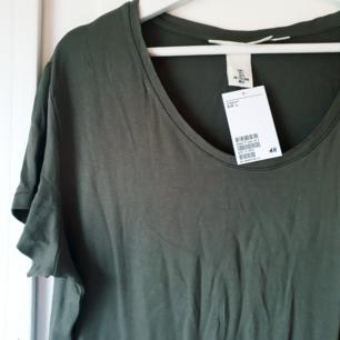Helt ny grön tisha från H&M L.O.G.G Militär grön, säljer för att den ej kom till användning 😊