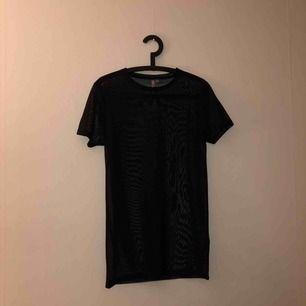 Mesh T-shirt, använd en gång.