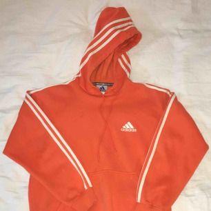 It'a a vintage adiadas hoodie in orange.  Please place bid