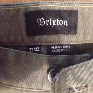 Brixton Reserve twill pants, sort of a dark sand olive color. Brand new. My phone sucks and won't take a picture of the whole thing but they fit regular. There's always google images ;) Can meet in Stockholm or post at buyers expense.