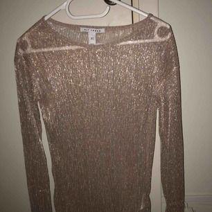 Fin glittrig långärmad tröja . Knappt använd ☺️