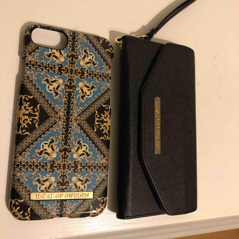 Skal och plånbok ideal of sweden iPhone 7.  Använt ett fåtal gånger med skalet är lite kantstött i ett hörn, syns inte alls tydligt . Frakten är inräknad i priset . . Accessoarer.