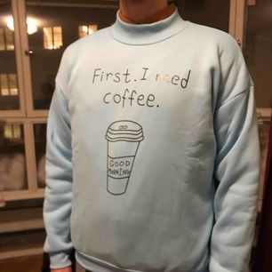 "A Christmas gift that was one size too big. Sky blue sweater with tagline ""coffee first"", new, never worn"
