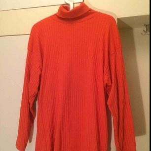 Bright orange Turtle neck!! Lovely on the skin and can b worn as dress/shirt if ur short enough :-)