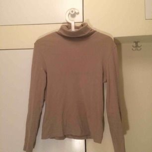 Beige basic turtleneck from St.oliver. Good quality and stretchy.