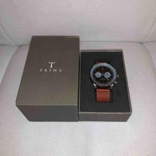 Klocka av märket Triwa använd ett fåtal gånger. Nypris 2495:-.
