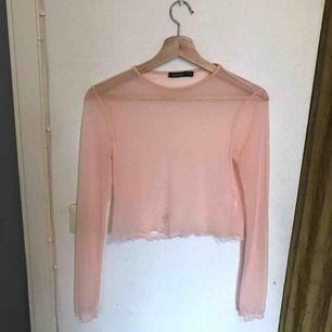 Rosa mesh-tröja! Köpt här på Plick men aldrig använd. Storlek S!