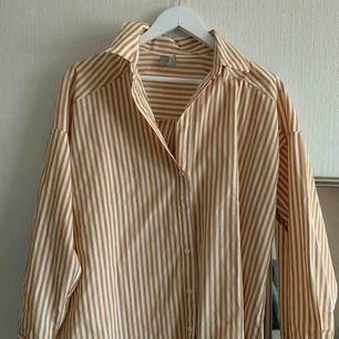 Oanvänd oversized skjorta från asos