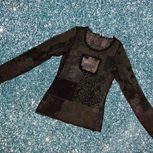 Vintage shirt with leopard print patchwork and a sheer black overlay.