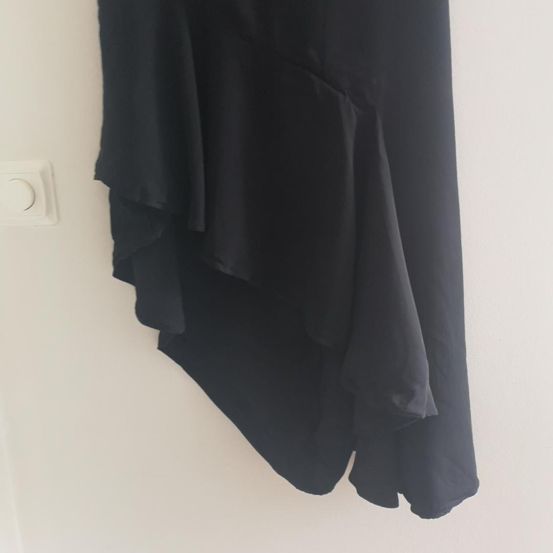 Draperad kjol från H&M . Kjolar.