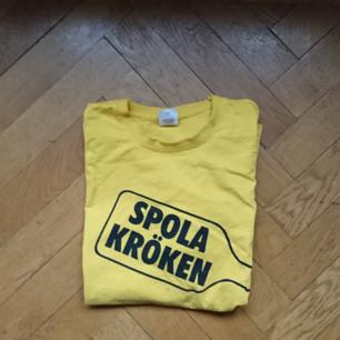 T-shirt med Systembolagets gamla reklam slogan