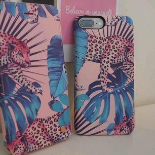 Ett plånboksskal med magnet från Hold it, i fint skick! Passar all iPhone plus modeller