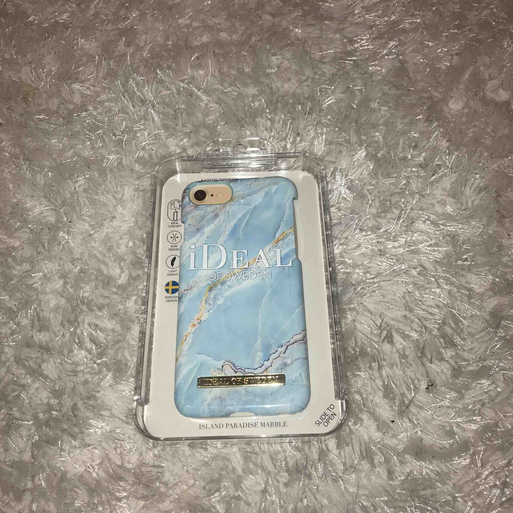 iPhone 7 skal från ideal of Sweden. Island paradise marble. Aldrig använt. Nypris 299kr men säljer för 150kr Du står för frakt om du ej har möjlighet att mötas upp i Stockholm.. Övrigt.