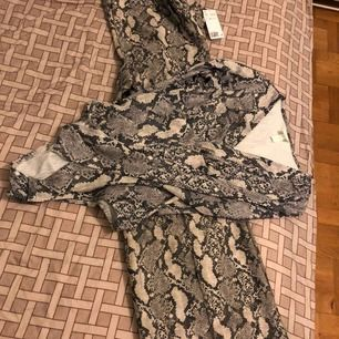 Set for two body plus trouser snake print.New with tags.Bought for 449 together.Selling for 250