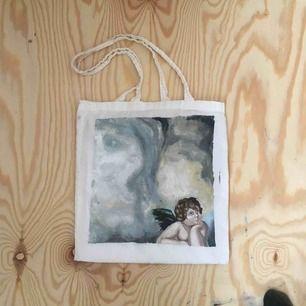 Handmålad tygpåse, inspirerad av Michelangelo. Målningen är gjord på en återvunnen tygpåse, och målningen är gjord med oljefärg.